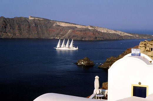 Greece, Cyclades islands, Santorini island, Caldeira and the sailing ship Club Med 1 seen from Thira village : Stock Photo