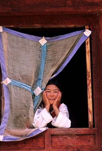 China, Eastern Tibet, little girl at a window at Ju-Lee monastery : Stock Photo