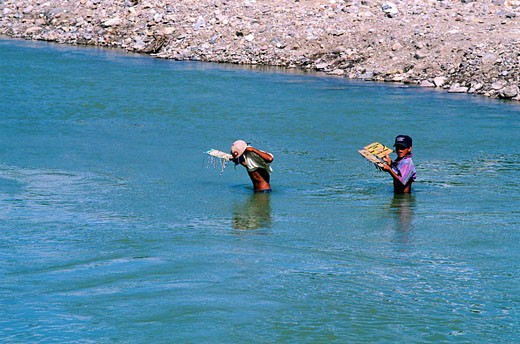 United States, Texas, USA/Mexico border, Big Bend National Park, young Mexicans crossing the Rio Grande river to sell souvenirs to tourists : Stock Photo