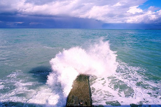 France, Seine Maritime, Saint Valery en Caux, Wave Breaking on the Wharf : Stock Photo