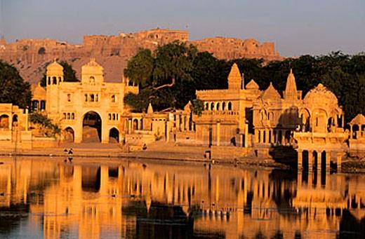 Stock Photo: 1792-65189 India, Rajasthan, Jaisalmer fort, Gadi Sagar lake, Tila ki Pol door and pavilions
