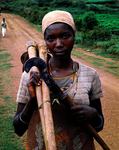 Burundi, Bujumbura Province, surroundings of Ijenda, Hutu woman coming back from fields, her face scarifications show she is Hutu, Tutsi people have never scarifications on face : Stock Photo