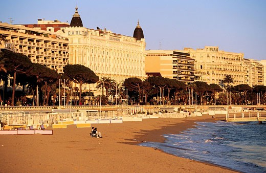 France, Alpes Maritimes, Cannes, the Croisette with the Intercontinental Carlton in the Center : Stock Photo