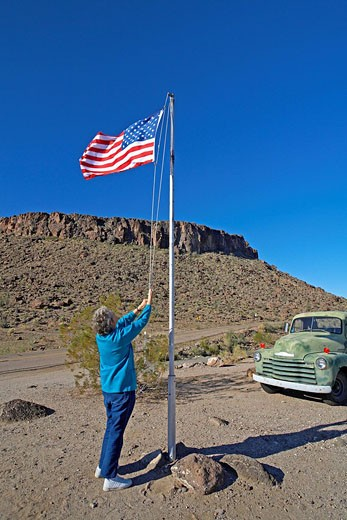 United States, Arizona, Route 66, Between Kingman and Oatman, American Flag Raised at Cool Springs Shop : Stock Photo