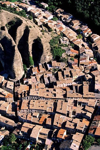 France, Alpes de Haute Provence, Les Mees village and rocks called Penitents aerial view : Stock Photo