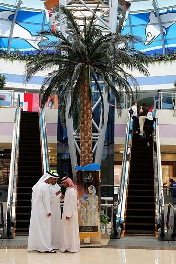 United Arab Emirates, Abu Dhabi, Emirians and tourists in Marina Mall : Stock Photo