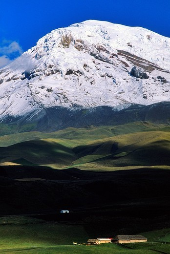Ecuador, Chimborazo province, Ecuadorian Andes, cultivated fields mosaic and farm on the slopes of Chimborazo volcano 6310 m : Stock Photo