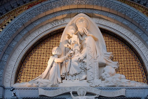 France, Hautes Pyrenees, Lourdes, Virgin Mary with a rosay appeared to Bernadette on the tympanum of the Rosary Basilica facade, Pictures taken with the authorization of the Sanctuaires Notre Dame de Lourdes Our Lady of Lourdes Sanctuaries : Stock Photo