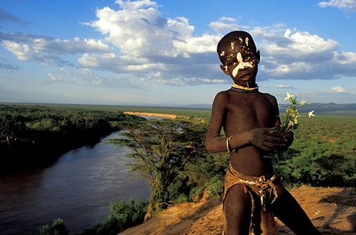 Ethiopia, Lower Omo Valley, listed as World Heritage by UNESCO, child of Karo Tribe on the Omo River banks : Stock Photo