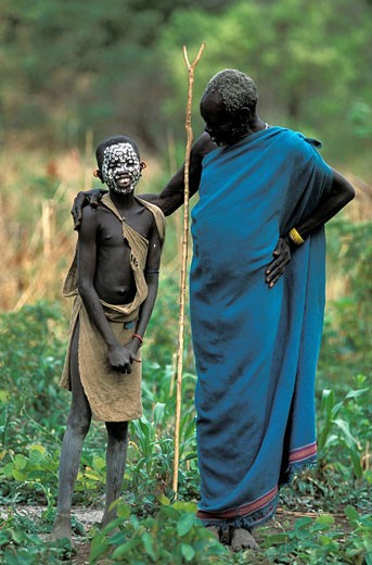 Ethiopia, Lower Omo Valley, listed as World Heritage by UNESCO, grandfather and his grandson from Surma Tribe, the forked stick designates the elderly man as the chief of his village : Stock Photo