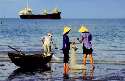 Vietnam, Ba Ria_Vung Tau Province, Vung Tau beach, fishermen tidying up their nets after the fishing : Stock Photo
