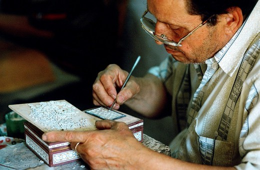 Egypt, Cairo, craftman making a marquetry with mother_of_pearl in Khan El Khalili souk : Stock Photo