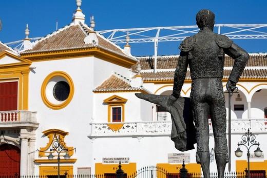 Stock Photo: 1792-93199 Spain, Andalusia, Sevilla, Plaza de toros, 18th century Arenas de la Maestranza Bullrings with local Baroque Style, the Curro Romero torero statue