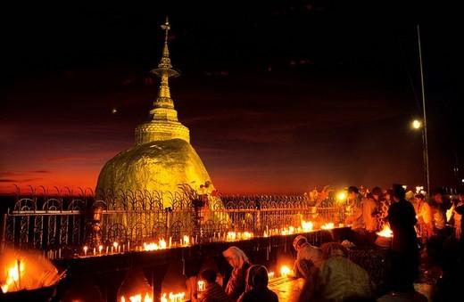 Myanmar Burma, Mon State, Kyaiktiyo Golden Rock, believers also pry by night : Stock Photo