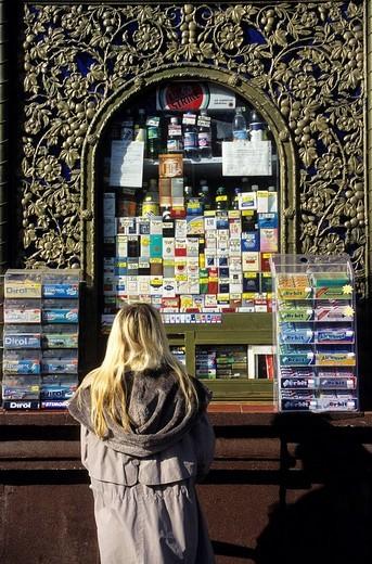 Ukraine, Kiev, Kreschatik Avenue, kiosk, packets of cigarette and sweets for sale : Stock Photo