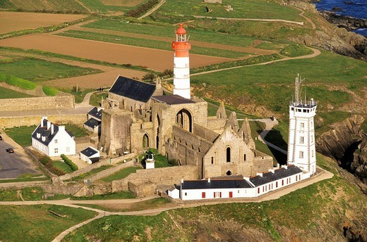 France, Finistere, Pointe Saint Mathieu, lighthouse and abbey aerial view : Stock Photo