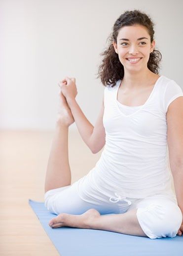 Stock Photo: 1795R-10135 Woman practicing yoga