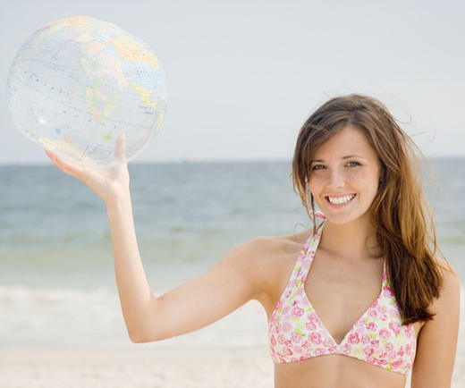 Stock Photo: 1795R-10331 Woman holding inflatable globe