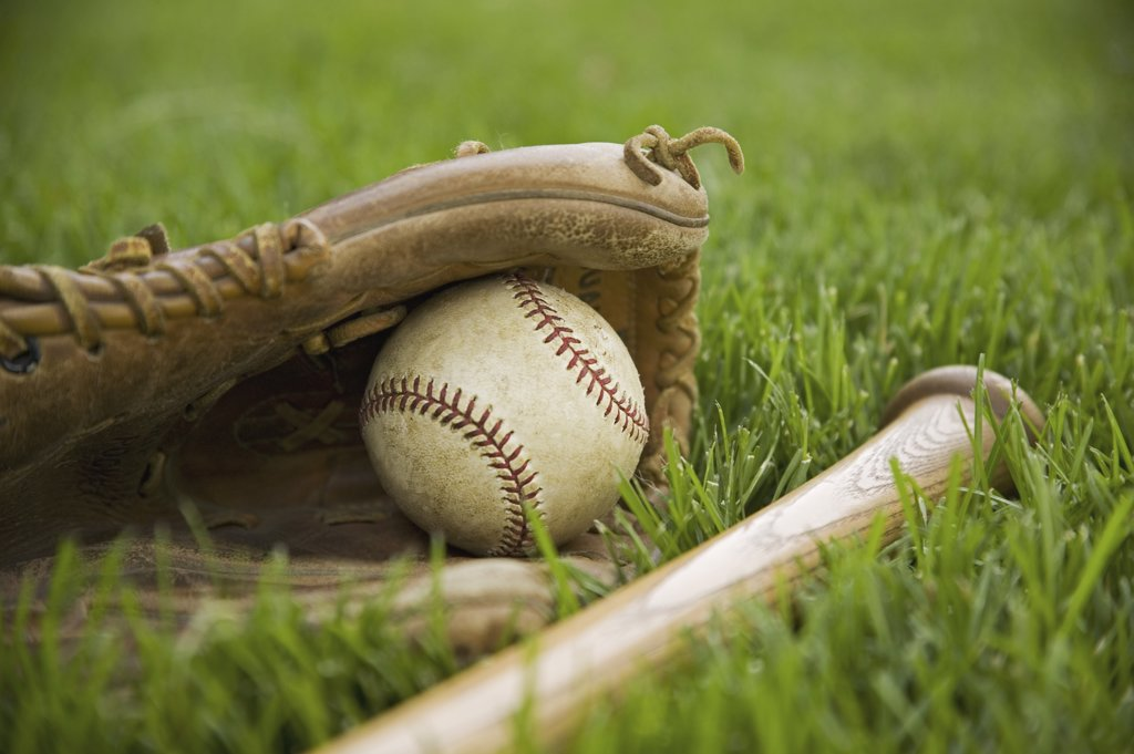 Stock Photo: 1795R-10420 Baseball equipment laying on grass