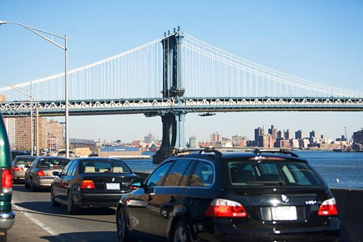 Traffic with bridge in background : Stock Photo