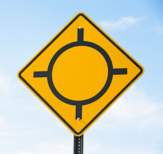 Low angle view of traffic circle sign : Stock Photo
