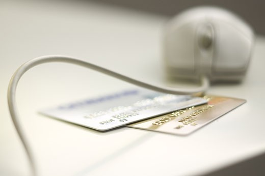 Stock Photo: 1795R-1071 Computer mouse and credit cards