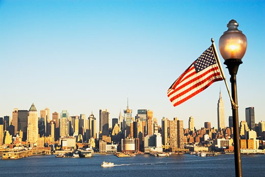 New York City skyline and American flag : Stock Photo