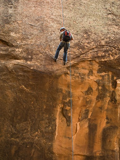 Man canyon rappelling : Stock Photo