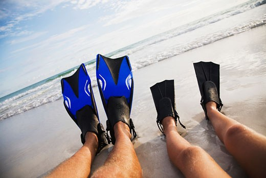 Stock Photo: 1795R-11964 Father and child wearing flippers, Florida, United States