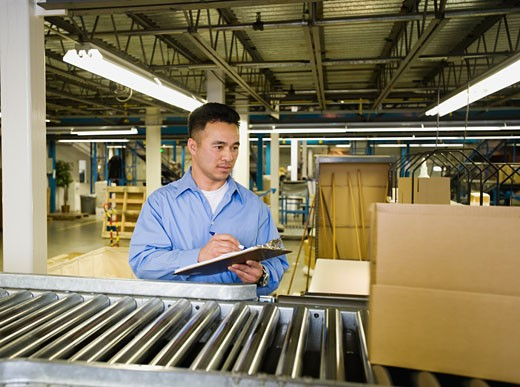 Stock Photo: 1795R-13205 Asian male factory worker checking product