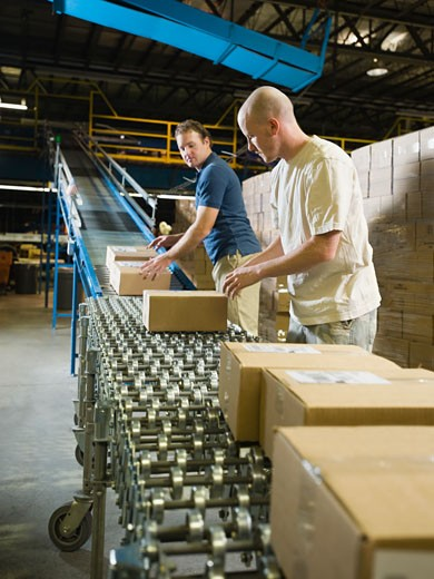 Stock Photo: 1795R-13210 Warehouse workers checking packages on conveyor belt