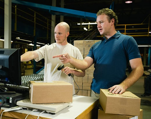 Stock Photo: 1795R-13214 Warehouse workers scanning packages
