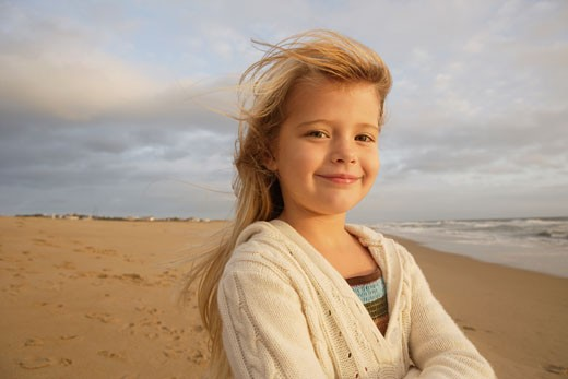 Girl with hair blowing at beach : Stock Photo