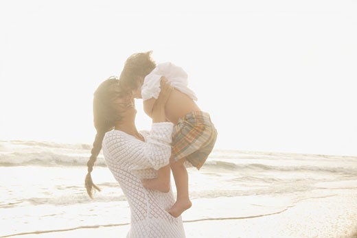 Stock Photo: 1795R-13330 Mother holding son at beach