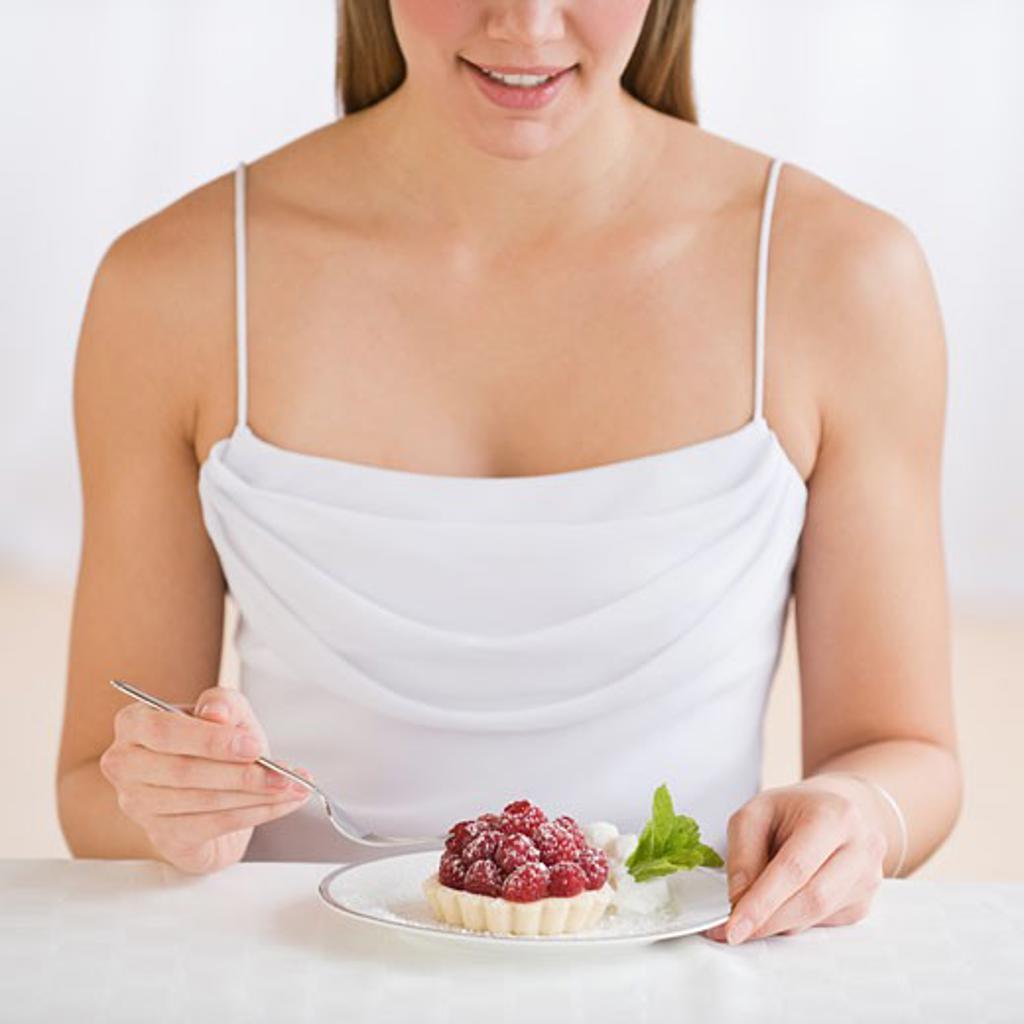Woman eating desert : Stock Photo