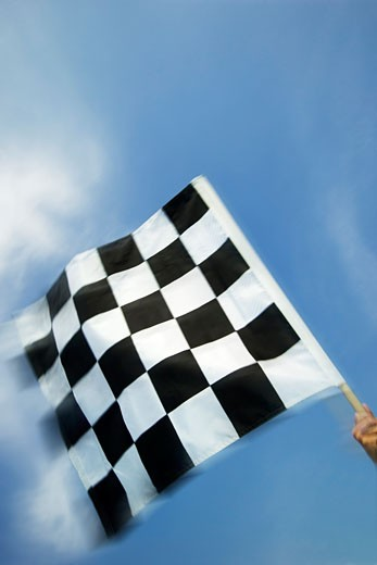 Hand waving checkered flag : Stock Photo