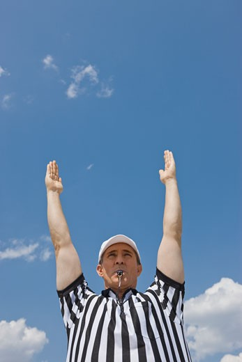 Male football referee making touchdown call : Stock Photo