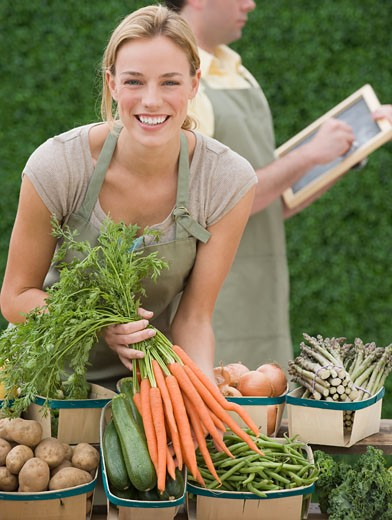 Stock Photo: 1795R-14328 Woman next to baskets of vegetables
