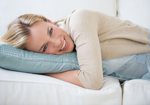 Woman laying on sofa : Stock Photo