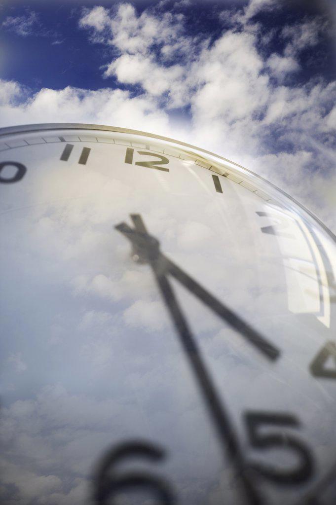 Close up of clock face and sky : Stock Photo