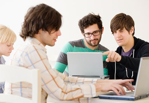 College students with laptops in classroom : Stock Photo