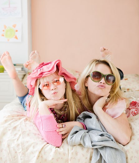 Mother and daughter playing dress up : Stock Photo