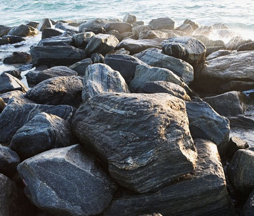 Rocks in front of water : Stock Photo