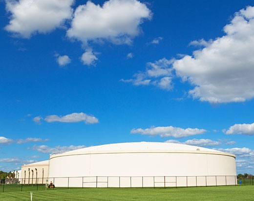 Oil refinery storage under blue sky : Stock Photo