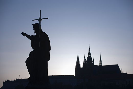 Silhouetted statue and cathedral : Stock Photo