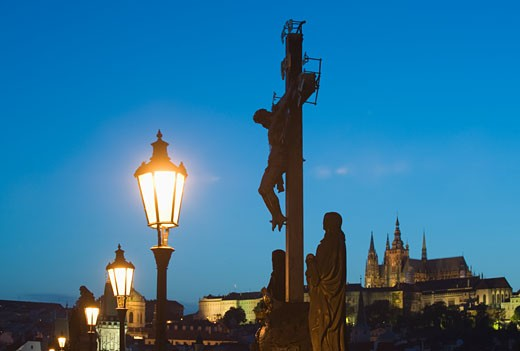 Night view of crucifix and cathedral : Stock Photo
