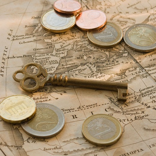 Stock Photo: 1795R-15774 Close up of euro coins, map and antique key