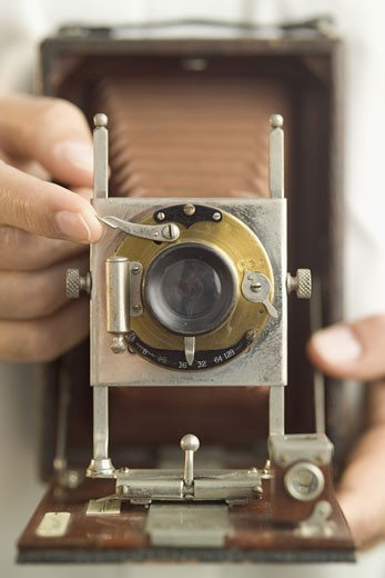 Using an antique folding camera : Stock Photo