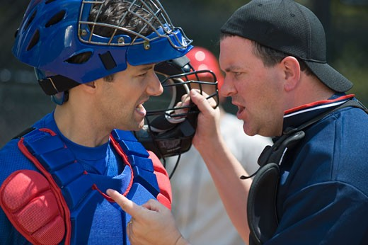 Baseball catcher arguing with umpire : Stock Photo