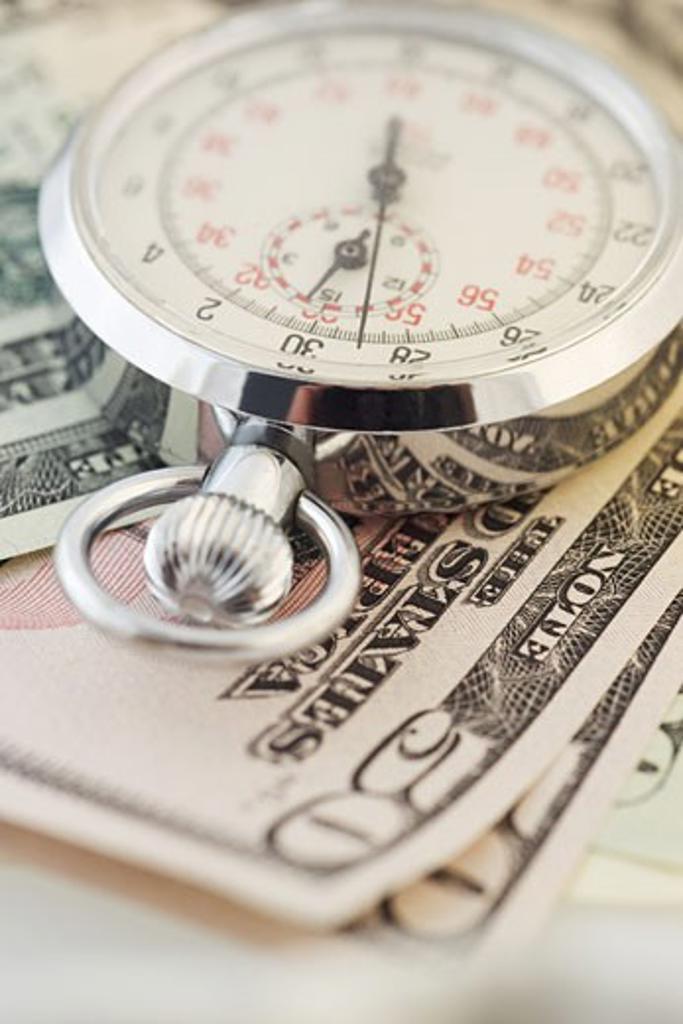 Still life of stopwatch and money : Stock Photo
